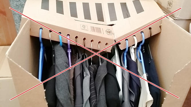 Akasztós ruhák szállítására alkalmatlan doboz